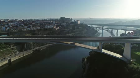 infante : Flying over bridges and Douro River in Porto at Portugal, 4k