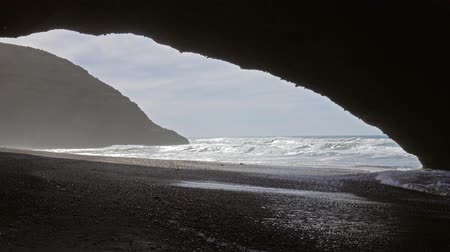 marokkó : Natural arch on Legzira beach, Atlantic coast in Morocco, Africa, 4k