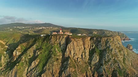 континентальный : Aerial view of the Cabo da Roca at sunset - the westernmost point of the continental Europe, Portugal, 4k