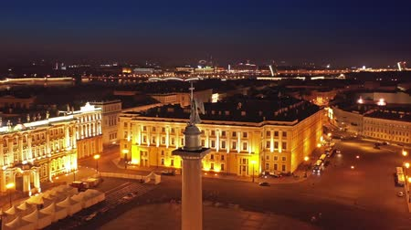winter palace : Aerial around view of the Alexander Column on Palace Square, the Winter Palace and the General Staff Building in St. Petersburg at night, Russia, 4k Stock Footage