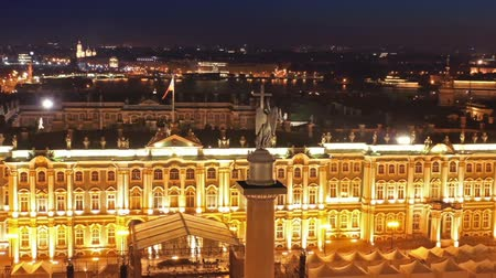 alexander column : Aerial around view of the Alexander Column on Palace Square, the Winter Palace and the General Staff Building in St. Petersburg at night, Russia