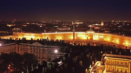 alexander column : Aerial view of the Winter Palace, the Alexander Column on Palace Square, and the General Staff Building in St. Petersburg at night, Russia, 4k Stock Footage