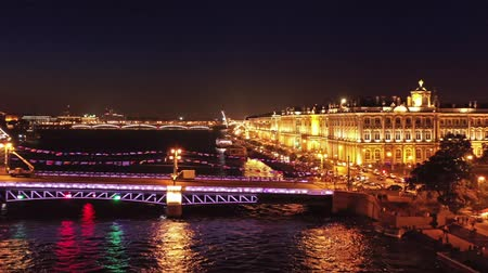 peter and paul fortress : Aerial panorama view of the drawn Palace bridge, Admiralty, Winter Palace, Peter and Paul Fortress and Rostral Columns in St. Petersburg at night, Russia, 4k Stock Footage
