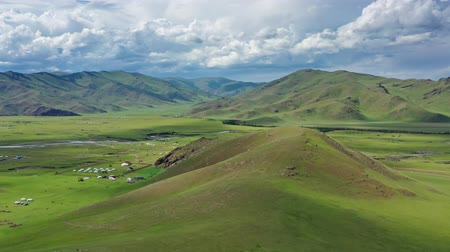 moğolistan : Aerial panorama view of yurts in steppe and mountains landscape in Orkhon valley, Mongolia, 4k Stok Video