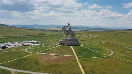 конный : Aerial around view of huge equestrian statue of Genghis Khan in the steppe, Mongolia, Ulaanbaatar, 4k
