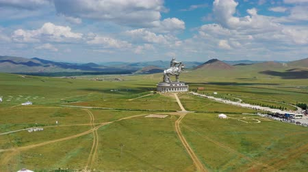 khan : Aerial around view of huge equestrian statue of Genghis Khan in the steppe, Mongolia, Ulaanbaatar, 4k