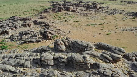 gobi : Rock formations and stacked stones in Mongolia Stock Footage