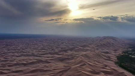 desolado : Aerial view of sand dunes in Gobi Desert at sunset