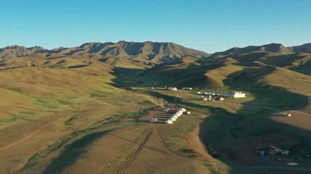 nomadic : Aerial view of yurts between montains Mongolia Stock Footage