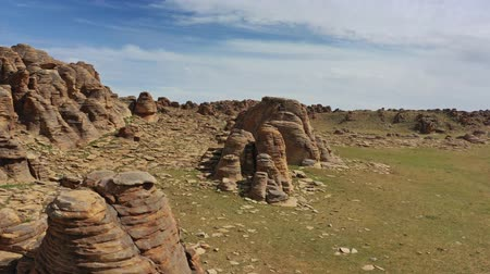 stacked rock : Rock formations and stacked stones in Mongolia Stock Footage