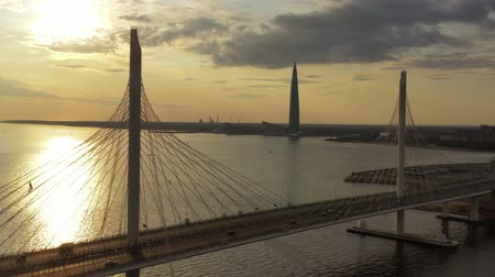 neva river : Cable-stayed bridge and new skyscraper Stock Footage