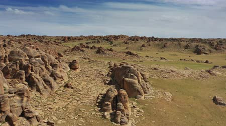 gránit : Rock formations and stacked stones in Mongolia Stock mozgókép