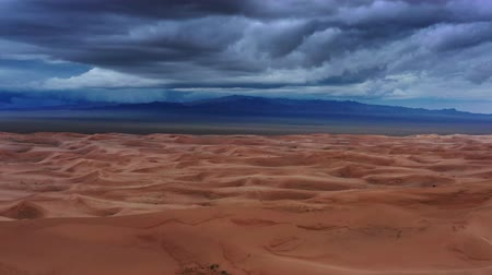 gobi : Aerial view on sand dunes with storm clouds