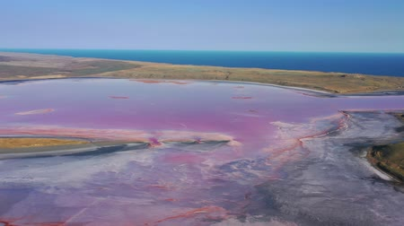 krím : Aerial view of pink lake near Black Sea in Crimea Stock mozgókép