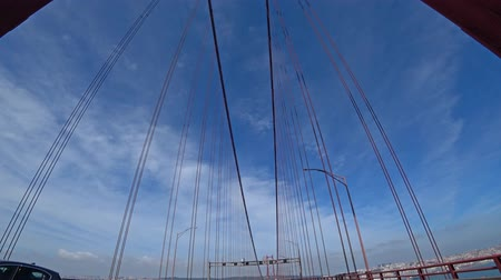 the suspension bridge : Driving on 25th of April bridge in Lisbon
