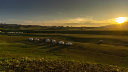 gobi : Landscape with yurts and mountains at sunset