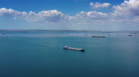 fleet : Many cargo ships waiting for port entrance