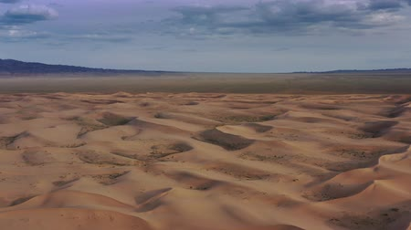 gobi : Aerial view of sand dunes in desert at sunset Stock Footage