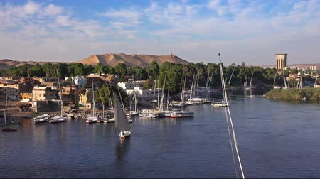 Нил : felucca boats on Nile river in Aswan Egypt
