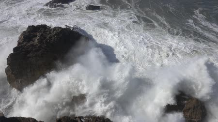 ciclone : High waves breaking on rocks slow motion