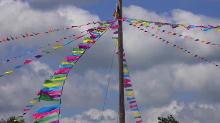 jubileu : Tall pole with colorful triangle flags on ropes