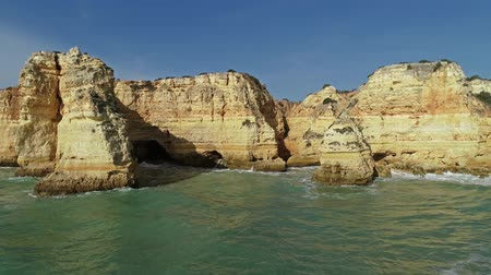lagos : Rock cliffs and waves in Algarve Portugal