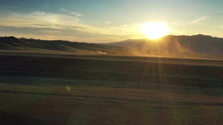 nomadic : Yurts between montains at sunset in Mongolia Stock Footage