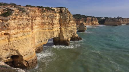 lagos : Rock cliffs and waves in Algarve, Portugal