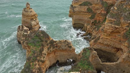 lagos : Rock cliffs and waves in the Algarve, Portugal Stock Footage