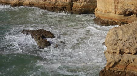 lagos : Rock cliffs and waves near in Algarve Portugal