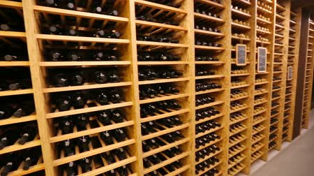 kvaš : Bottles with wine stacked on wooden racks