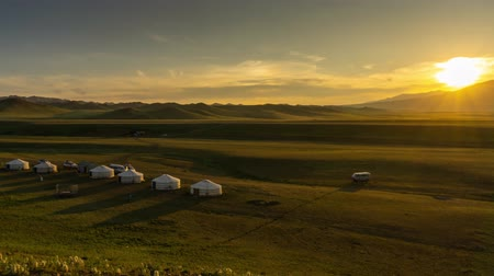 moğolistan : traditional yurts and mountains at sunset Mongolia