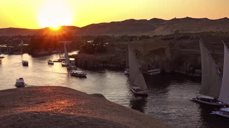 ルクソール : felucca boats on Nile river in Aswan at sunset 動画素材