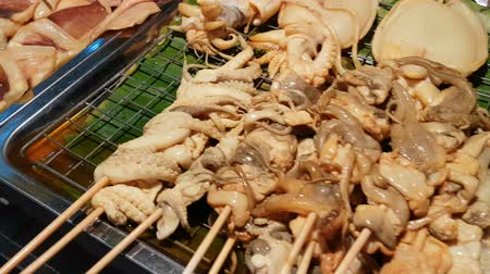 kalamar : fresh squid for grilled with closeup shot, street food in Thailand