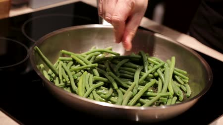 prepaid : Man cooking organic beans close up video