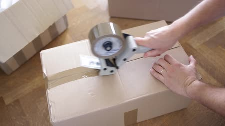 prepaid : House moving concept  Man packing cardboard box