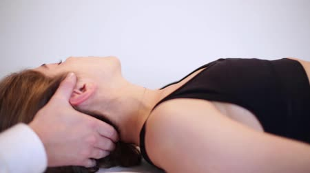dorsal : woman having chiropractic adjustment osteopathy