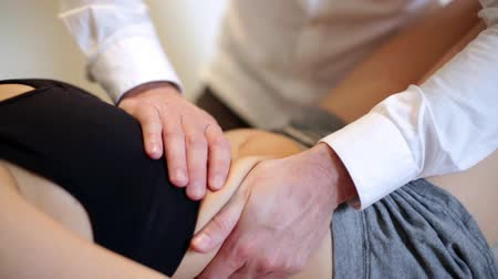 handling : woman having chiropractic adjustment osteopathy