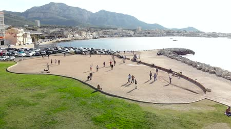 Marseille, sea, beach and petanque under the sun of the Mediterranean - Drone view 4K