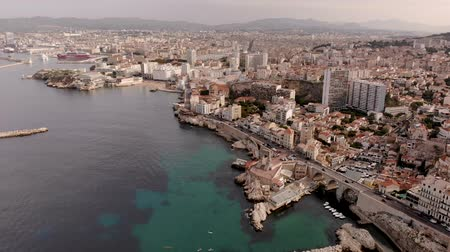 Marseille city and coastline amazing aerial view 4K with Corniche Kennedy, Vallon des Auffes, Notre Dame de la Garde, les Catalans - Travel in south of France