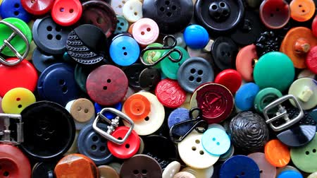 Long ago they decorated costumes and dresses. Buttons of different colors, from big to small, buckles and hooks, they got worn out and become unnecessary.