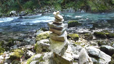 On the shore of a swift, mountain river, people built pyramids out of stones.