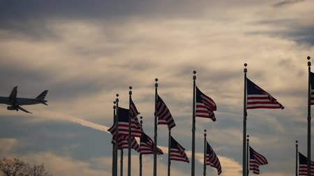 Washington monument USA flags in the sky sunset on the plane policy pride patriotism