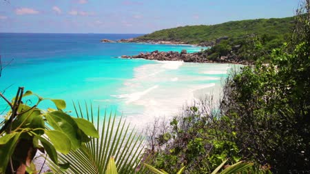 la digue island : small waves and white beach Anse petit at Seychelles islands. La Digue, Anse Cocos. Stock Footage