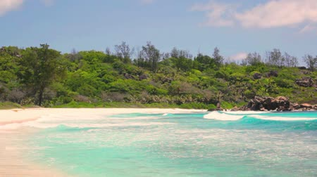 seychely : small waves and white beach at Seychelles islands. La Digue, Anse Cocos.