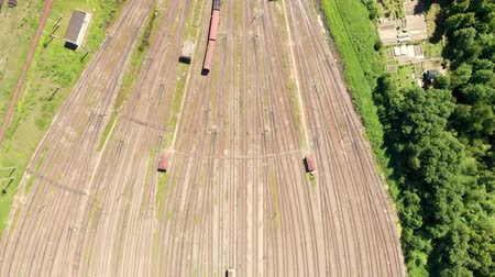 navlun : Branches of the railway at the marshalling yard, a lot of freight wagons from the height. Wagons with coal moving on rails Stok Video