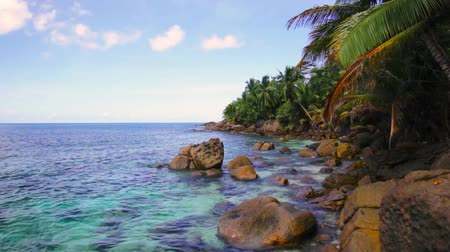 Small waves and huge boulders on the beach at Seychelles islands. La Digue, Anse Cocos. Stock Footage