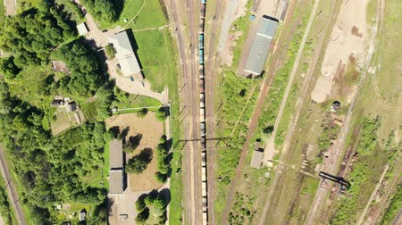 Branches of the railway at the marshalling yard, a lot of freight wagons from the height. Wagons with coal moving on rails Stock Footage
