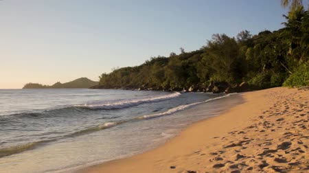 la digue island : small waves and white beach at Seychelles islands. Mahe, Anse Takamaka. Stock Footage