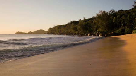small waves and white beach at Seychelles islands. Mahe, Anse Takamaka. Stock Footage